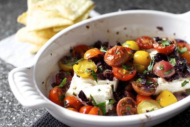 broiled feta with tomatoes and olives by smitten    http://smittenkitchen.com/blog/2012/08/mediterranean-baked-feta-with-tomatoes/?utm_source=feedburner_medium=feed_campaign=Feed%3A+smittenkitchen+%28smitten+kitchen%29_content=Google+Reader