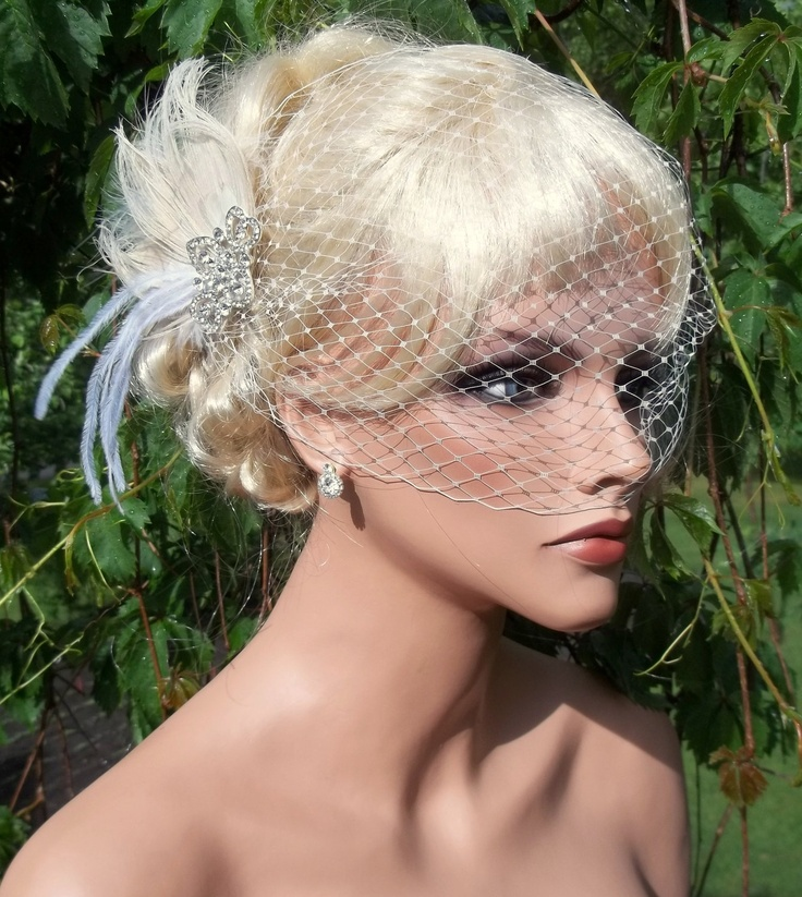Ivory bridal hair fascinator and french net bandeau wedding veil, vintage style brooch, feather fascinator -ship ready OOAK. $64.00, via Etsy.