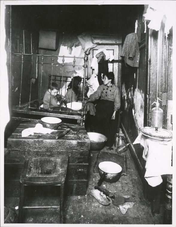 Poverty.  A rear tenement room, New York (1900-1937)   Photo: L.W. Hine