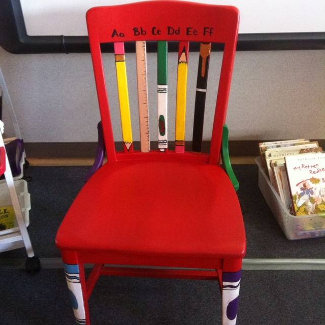 Cute teacher chair- love the pencils and crayons painted on. This could also be my writers chair.