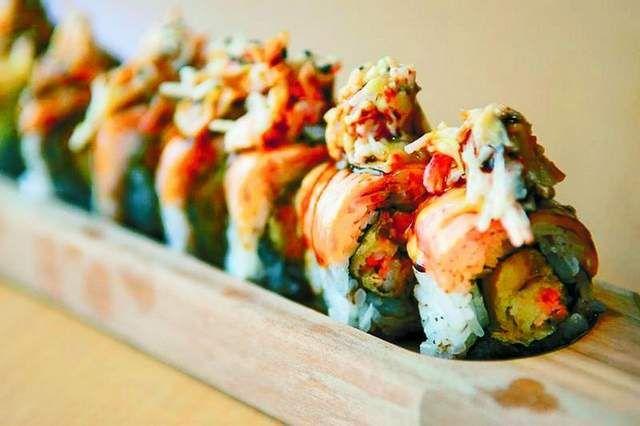 crab, mango, tempura shrimp, charred salmon, macadamia nuts and teriyaki sauce