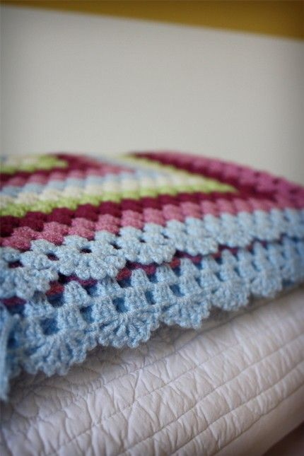 stunning edge on crochet blanket - Links to Etsy. No pattern, but looks like a double crochet shell stitch with a picot in between each dc? Looks easy to reverse engineer.