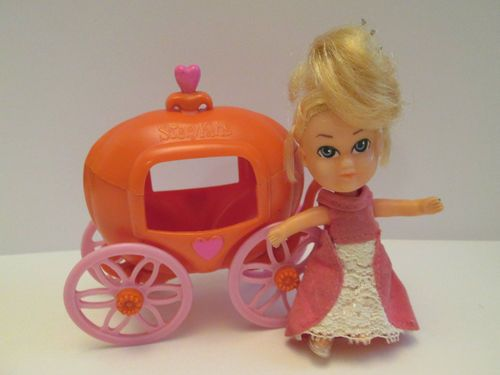 1967 Liddle Kiddles Hasbro StoryKins Cinderella Doll w/Pumpkin Coach  My grandma had this toy for us to play with when we came to visit. I always thought that it was a little bit stupid cause the doll didn't fit in the thing very well. and the wheel broke cause they weren't made very well. My grandma glued them back on, but then we had to be careful cause they would break off.