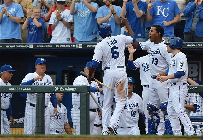April 08, 2013; Kansas City, MO, USA; Kansas City Royals center fielder Lorenzo Cain (6) celebrates with his teammates after scoring to tie the game against the Minnesota Twins during the eighth inning at Kauffman Stadium. Mandatory Credit: Peter G. Aiken-USA TODAY Sports