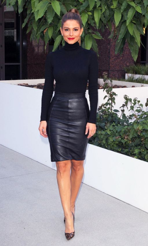 Black Polo teamed with Black Leather Skirt. Add Red lipstick.