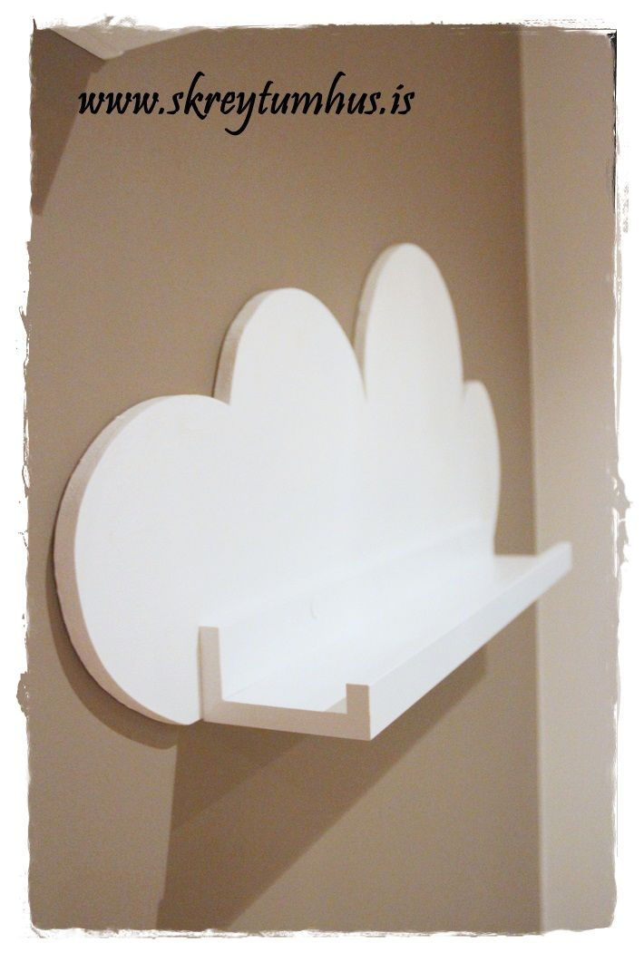 Ikea Ribba Shelf used as basis for tree and cloud-shelves for a kids room.