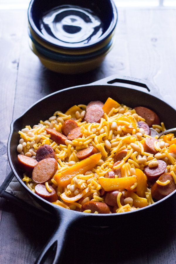 Cheesy Cajun Pasta starts with a box, but with peppers, andouille sausage and beans, you end up with a family pleasing, quick cooking meal! lemonsforlulu.com #MACNATOR