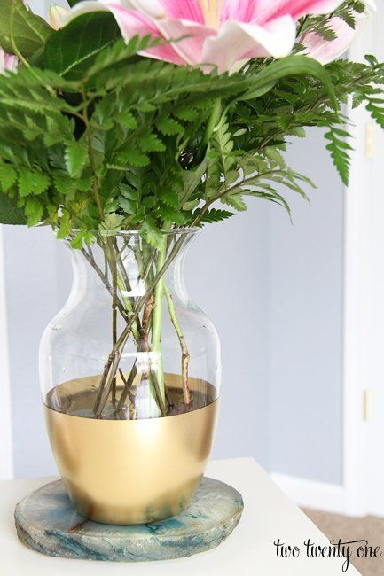 gold dipped vase.   20 Ways To Update Everything Using Gold Spray Paint | Apartment Therapy
