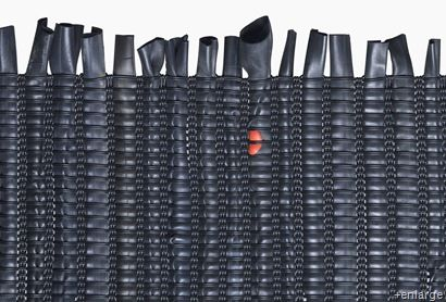 Recycled bike innertube rug.  Now I'll be looking forward to our tires going flat!