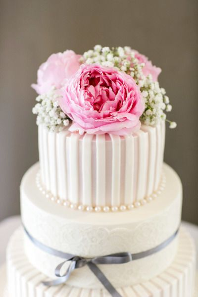 Flowers, piped icing, pearls, ribbon...this cake is stunning! #wedding #cake #inspiration