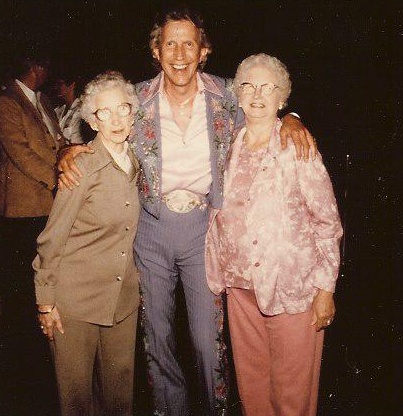 My Mother & Aunt Corrine visiting with Porter Wagonner just before he goes on stage to perform - outside his dressing room. Treated them royally - took them to sit on stage while he performed.