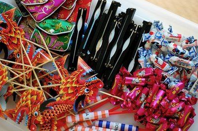 chinese party favors - small coin purse, fans, white rabbit candy, fruit candy, dragon toothpicks, chinese yoyos