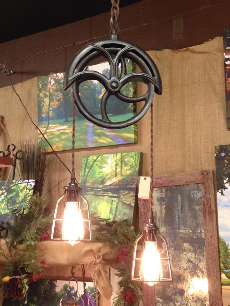 Early 1900's cast iron barn pulley pendant light with Edison bulbs on cotton covered cord.