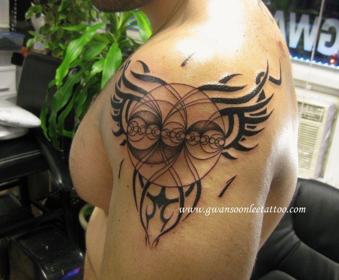 Fibonacci circles sequence tattoo with tribal designs on arm