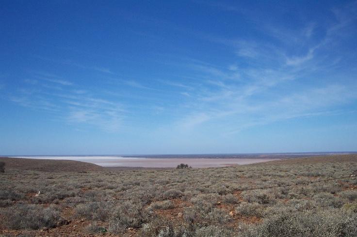 Photo by Wayne Elliott of dry lake near Woomera ,Australia.Big sky country !!
