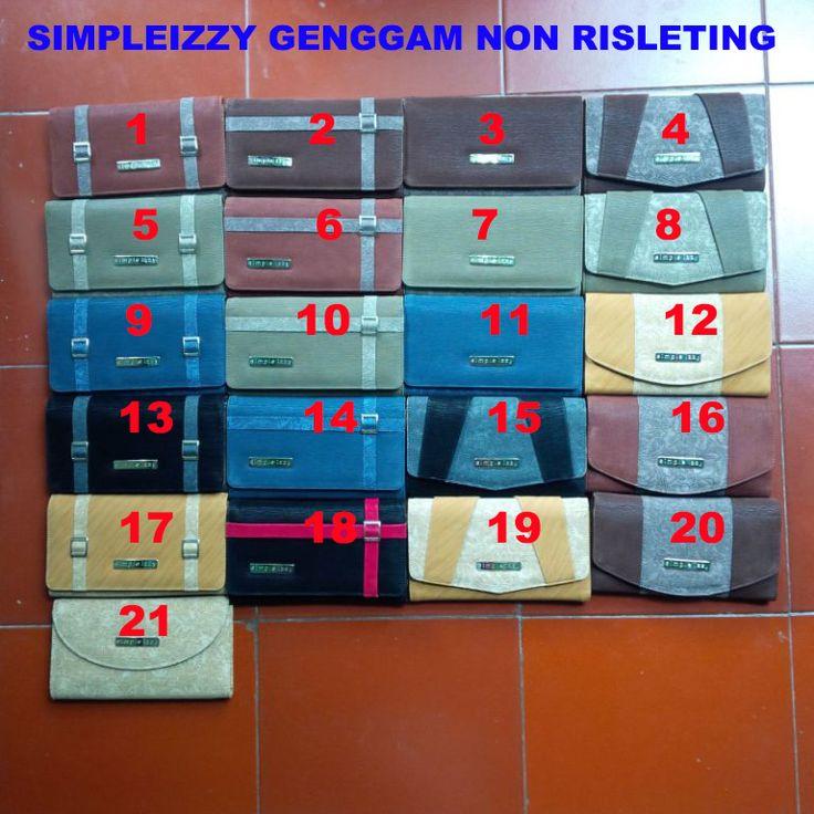 Spesifikasi Dompet Tangan Simple Izzy - Grosir Tas Branded,Tas Anak,Baju Muslim,Dompet Wanita, Sprei Murah