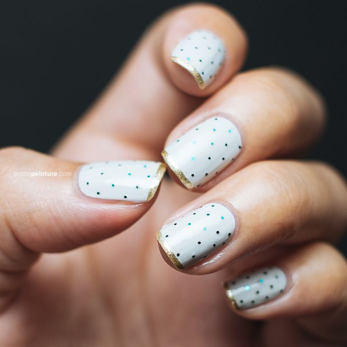 polka dot manicure with gold tips