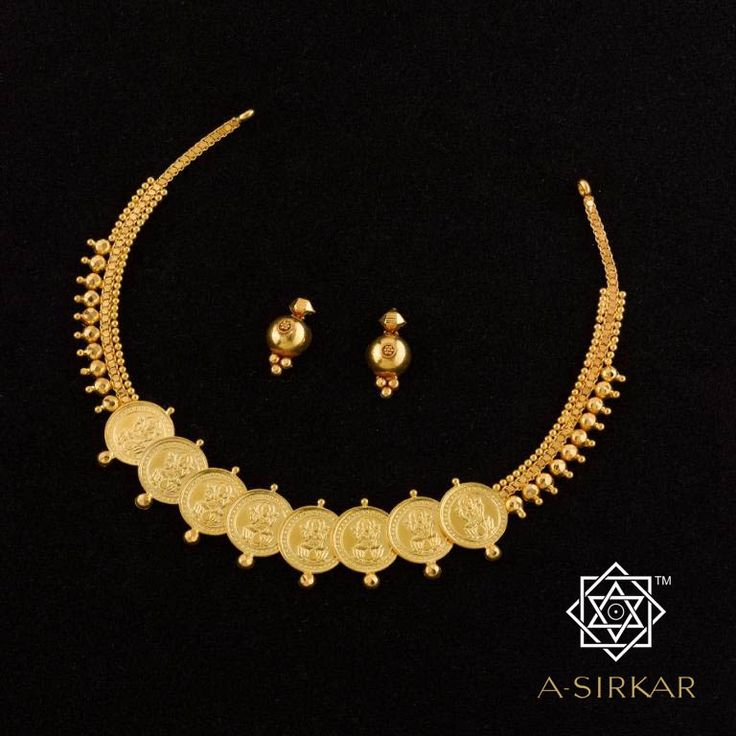 Ashtalakshmi Necklace:  Eight overlapping coins with MahaLakshmi imprinted on them takes centrestage in this diminutive untraditional ornament. This divine octet references the eight forms of Lakshmi and works as a lucky charm that protects and blesses in equal parts. The solid gold balls at the top and bottom of each coin is an essential detail that keeps those coins from denting and also guards the skin against the edges of the medallions. Made in natural yellow 22ct gold.