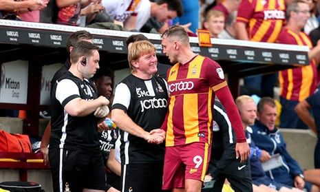 The Bradford City manager, Stuart McCall, shakes hands and congratulates Charlie Wyke after the striker's hat-trick against Bristol Rovers. Great picture! Cheers Stuart