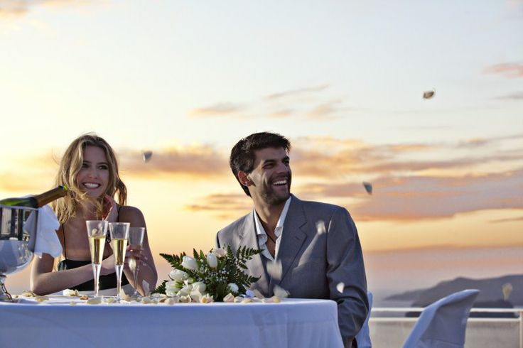 A romantic #dinner watching the dreamy #sunset is waiting for you. What are you waiting for to fall in #love with #Santorini?