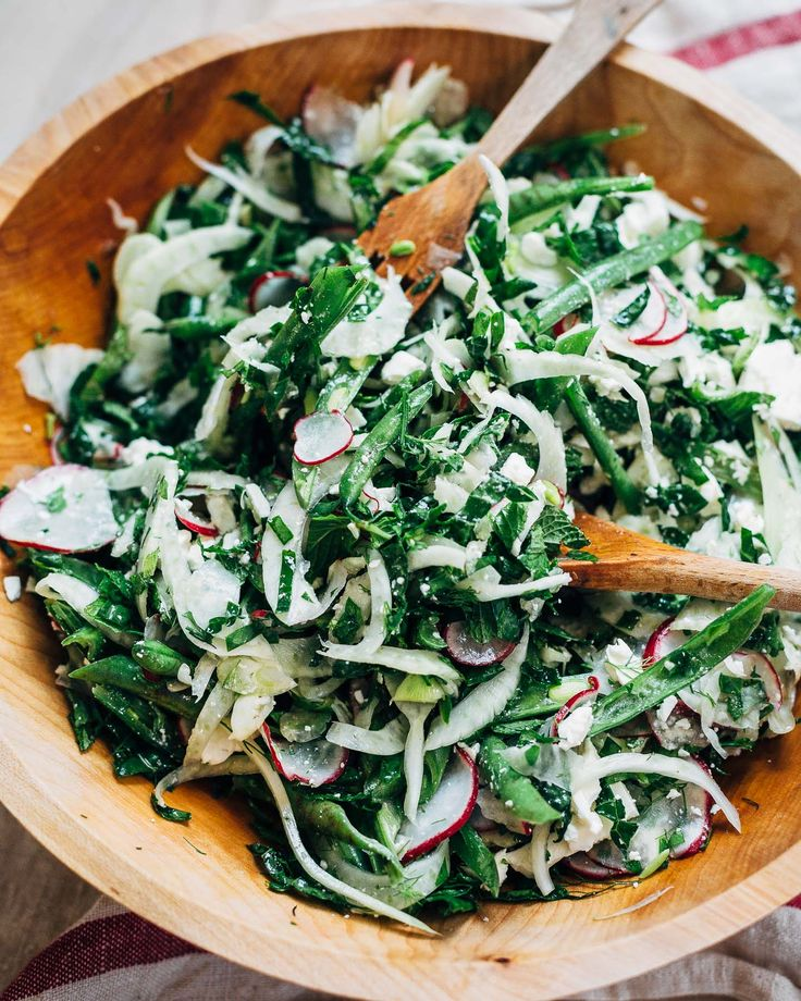 From Lily Diamond's cookbook, Kale & Caramel: Recipes for Body, Heart, and Table, a kale salad with radishes, fennel, green beans, and fresh herbs.