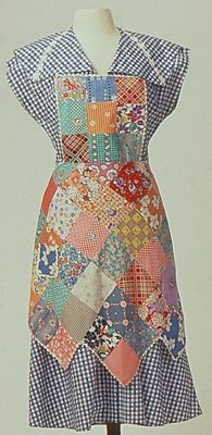 cute patchwork apron...  My grandma made me one of these without the bibb when I was a little girl!.  I was so proud of it.
