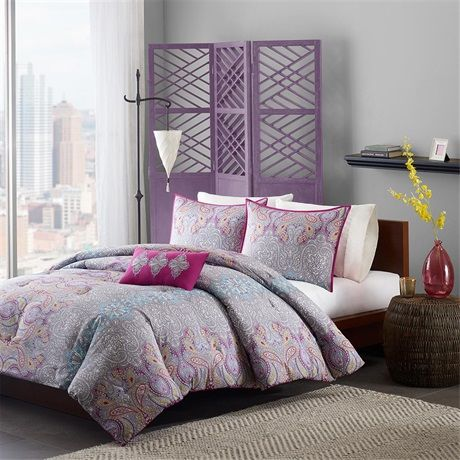 The Mi Zone Keisha Comforter Set provides a modern look with pops of bright color. This overscaled paisley motif uses shades of fuschia, grey, yellow and blue on the top of bed and sham for a dramatic feel. Made from a polyester peach skin fabrication, this comforter and sham are soft to the touch and have a brushed polyester reverse. One decorative pillow shows off the bright fuschia color as its base while decorative embroidery pops three medallions pulling this entire look together.
