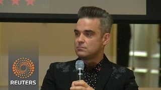 """Robbie Williams announces European Stadium Tour  Robbie Williams announces 2017 European stadium tour says he would join his former Take That bandmates for a reunion """"at some point"""" and jokes about his daughter. Jane Witherspoon reports. Subscribe: http://smarturl.it/reuterssubscribe More updates and breaking news: http://smarturl.it/BreakingNews Reuters tells the world's stories like no one else. As the largest international multimedia news provider Reuters provides coverage around the…"""