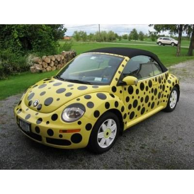 Good 2007 VW Beetle Convertible With Daisy Flower Wheels, Exterior Color Yellow  With Black Dots And Car Eyelids.