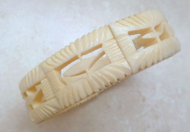 Vintage carved bone stretch panel bracelet The bracelet is formed from carved bone panels in a modernist open work whale design The panels are set on