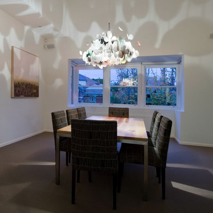 The unique lighting by Marc Pascal adds character and an extra dimension to this Fasham dining room!