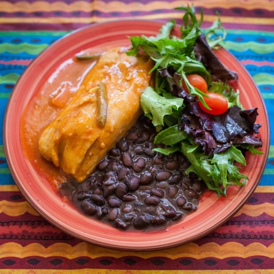 Erin's Potato & Green Bean Tamale, ranchero sauce with black beans, mixed greens with honey lime vinaigrette at La Borinquena Mex-icatessen photo by Paula Wirth