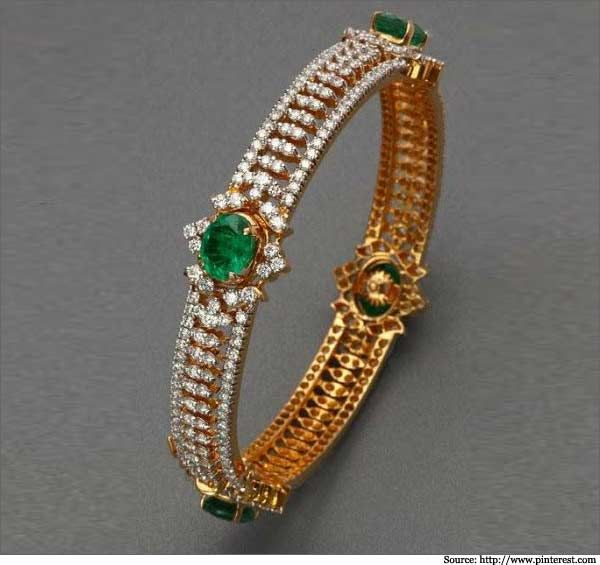 Here, the diamonds are arranged on the fringes with intricate layers in the middle. The emeralds impart splendor to the piece! - See more at: http://www.metromela.com/diamond-bangles/#sthash.7djLUQCo.dpuf