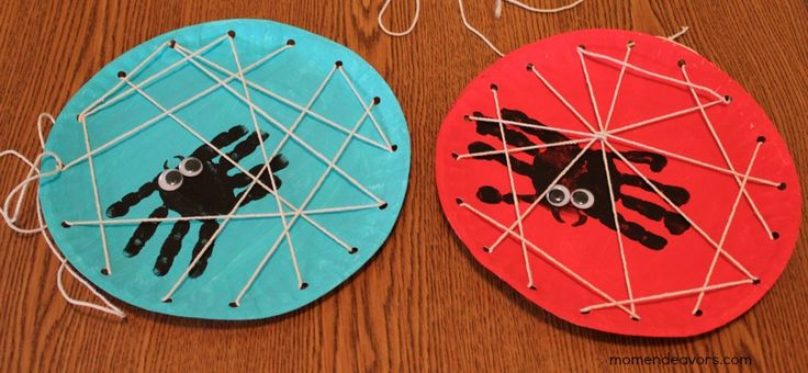 What fun for kids! Handprint spiders teamed up with a DIY lacing card web! Tutorial at Mom Endeavors