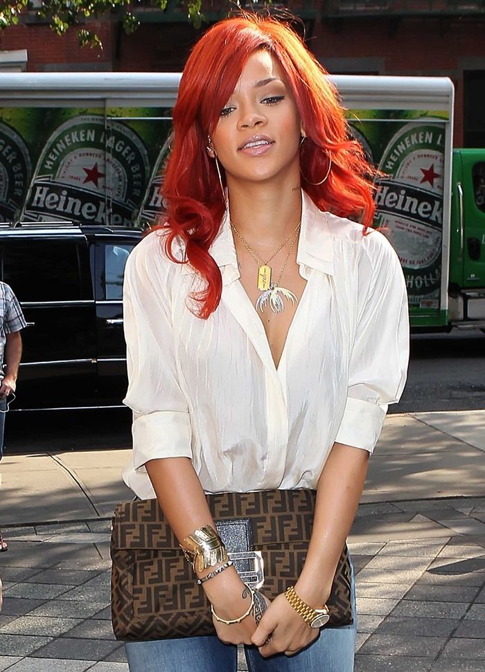 Rihanna carrying a large Fendi clutch with her House of Harlow bracelet in New York City on July 20, 2011