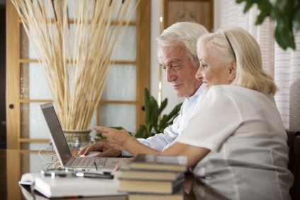 Two people in front of laptop