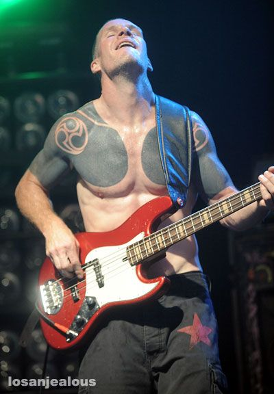 Tim Commerford -Rage Against the Machine. my guy's favorite band, but i'm the one who's seen them live lol