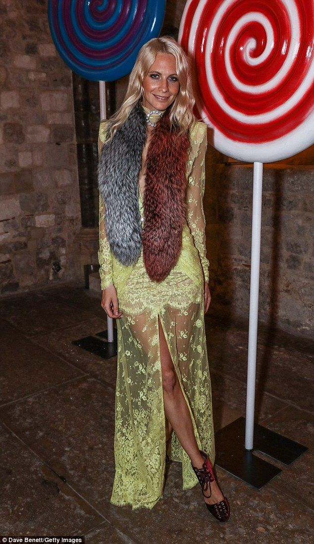 Mellow yellow:The 30-year-old model and socialite wowed in an incredible sheer lace gown ...