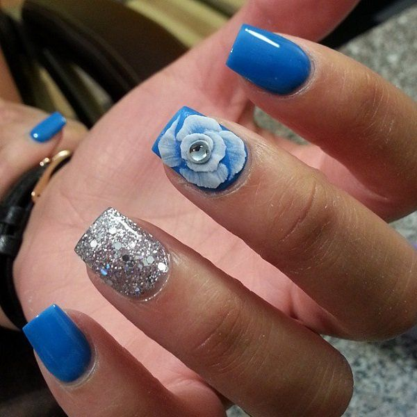 why are outlet stores cheaper Feel the flower power with this blue and silver themed fall nail art design complete with silver beads and silver glitter polish