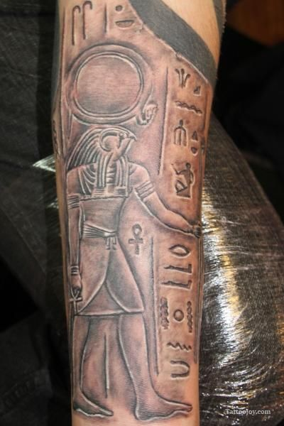 RA or Ré Sun God Egyptian Hieroglyphs Tattoo or a temple wall