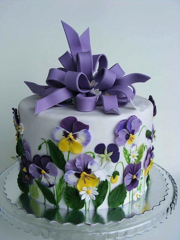 Found on the webs. Beautiful purple pansies on a cake. Yummy