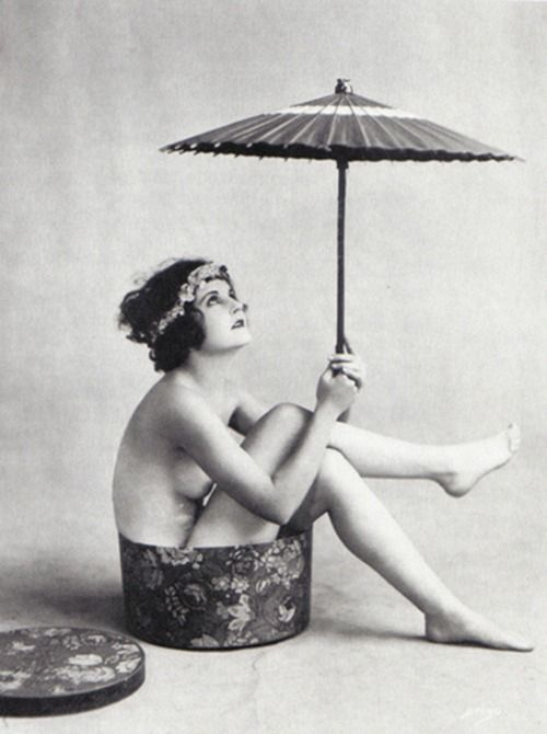 avoiding a sunburn and sitting in a hatbox.