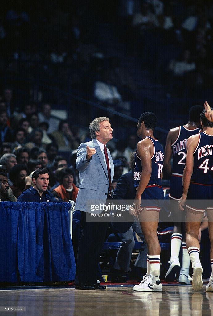 Head coach Hubie Brown of the New York Knicks talks with his players while there's a timeout against the Washington Bullets during an NBA basketball game circa 1984 at the Capital Centre in Landover, Maryland. Brown coached the Knicks from 1982-87.