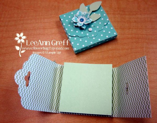 """These are some of my friend Pat's creations - Post-It holders using the Tag Topper Punch. She used the Petite Petals stamp set and coordinating punch and the Bird Builder punch on the front. It helps to use 2"""" or smaller post-it notes. Cut a 2"""" wide strip of designer paper or card stock about 6"""" long. Punch the end with the Scallop Tag Topper punch. Place the post-it note inside the strip and start folding the ends over each..."""