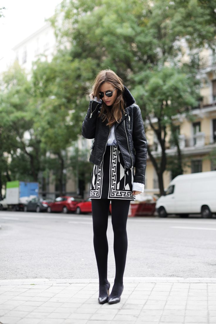 Shearling And Sheepskin Trend, Autumn/Winter --- Silvia Zamora is wearing a black shearling trim leather jacket from Zara