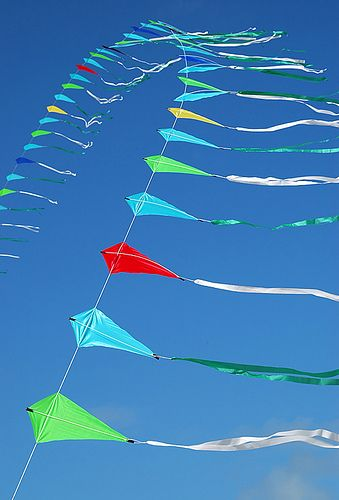 String of kites by Rob Huntley, via Flickr. At the 2007 Barmouth Kite Festival, on the beach at Barmouth, Wales, UK.