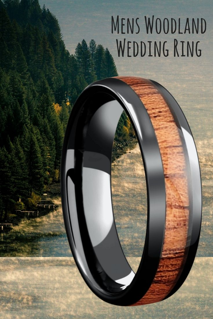 Mens woodland wedding ring. This mens wood wedding ring is 6mm in width  and crafted out of black high tech ceramic and inlaid with genuine koa wood.
