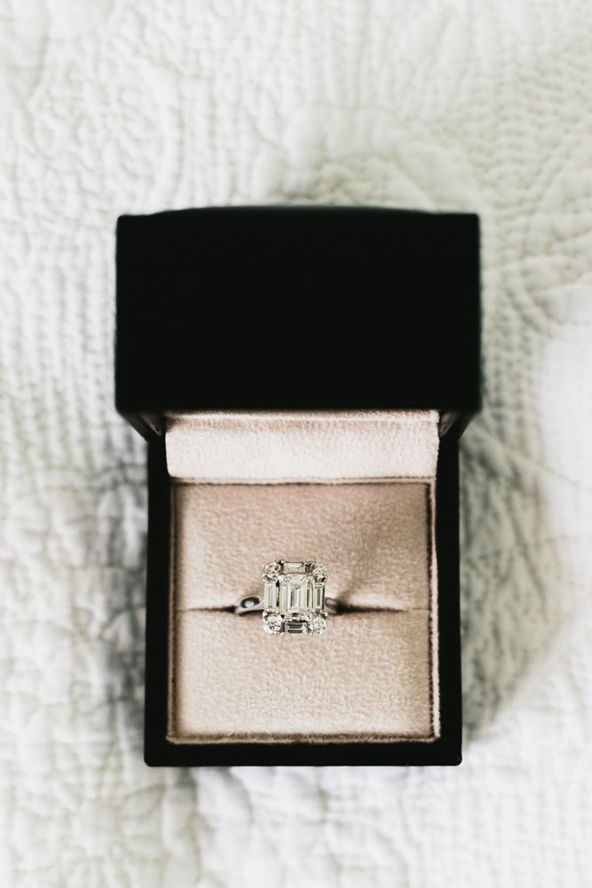 The prettiest emerald cut engagement ring! Wouldn't mind the big question being popped with the ring in this box! // Photography by Erin + Tara