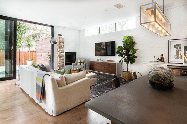 Transitional Living Room by Steele Street Studios - cool firewood rack