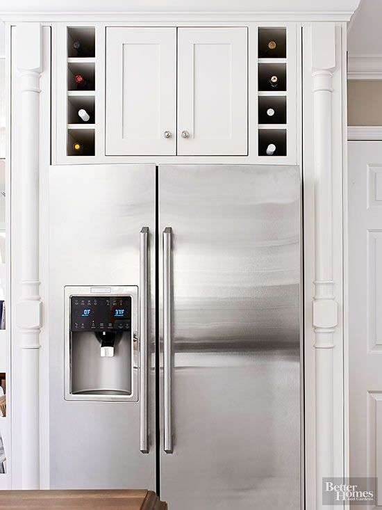 Avoid countertop clutter with clever wine cubbies. The small-scale nooks make good use of space above a refrigerator and expand the kitchen visually. Because heat rises, store sparkling wines on the lowest shelf, white wines above them, and reds at the highest level.